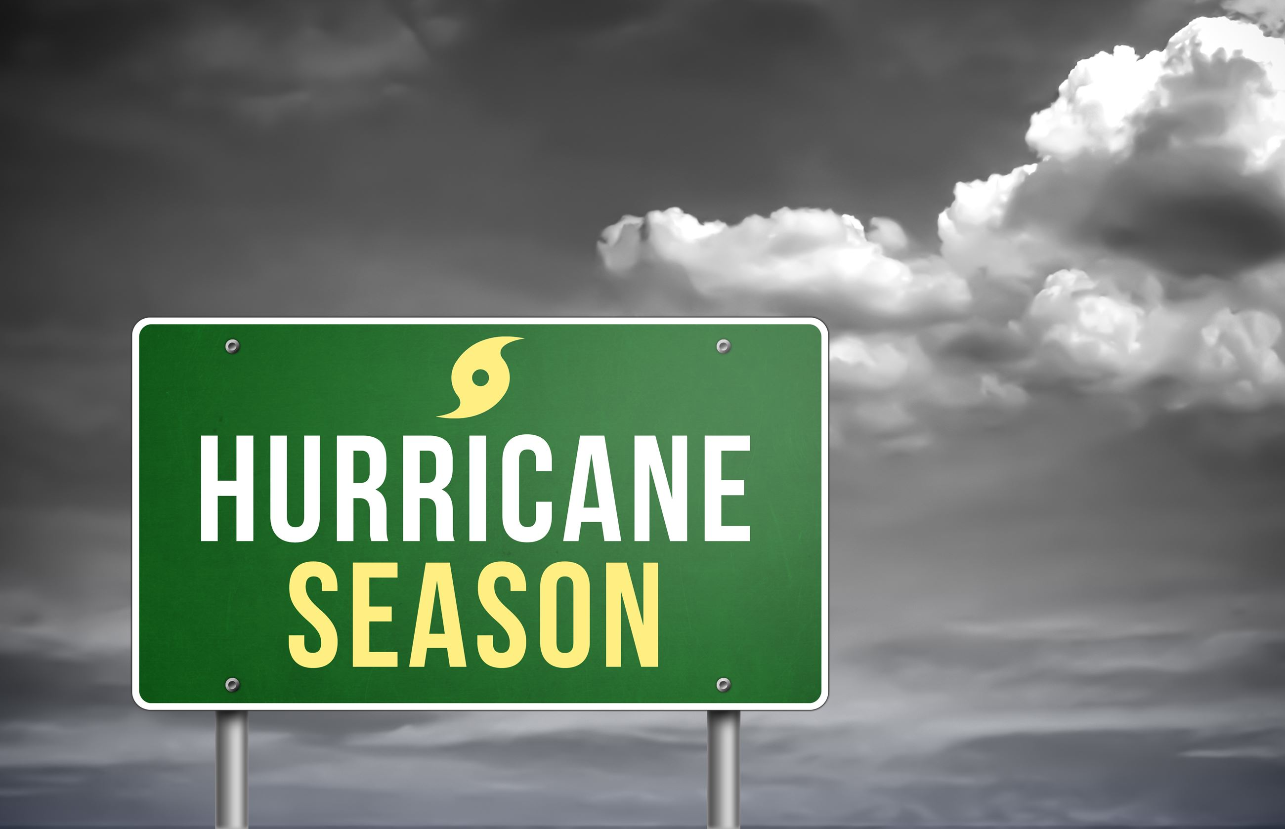 Sign warning Hurricane Season with storm approaching