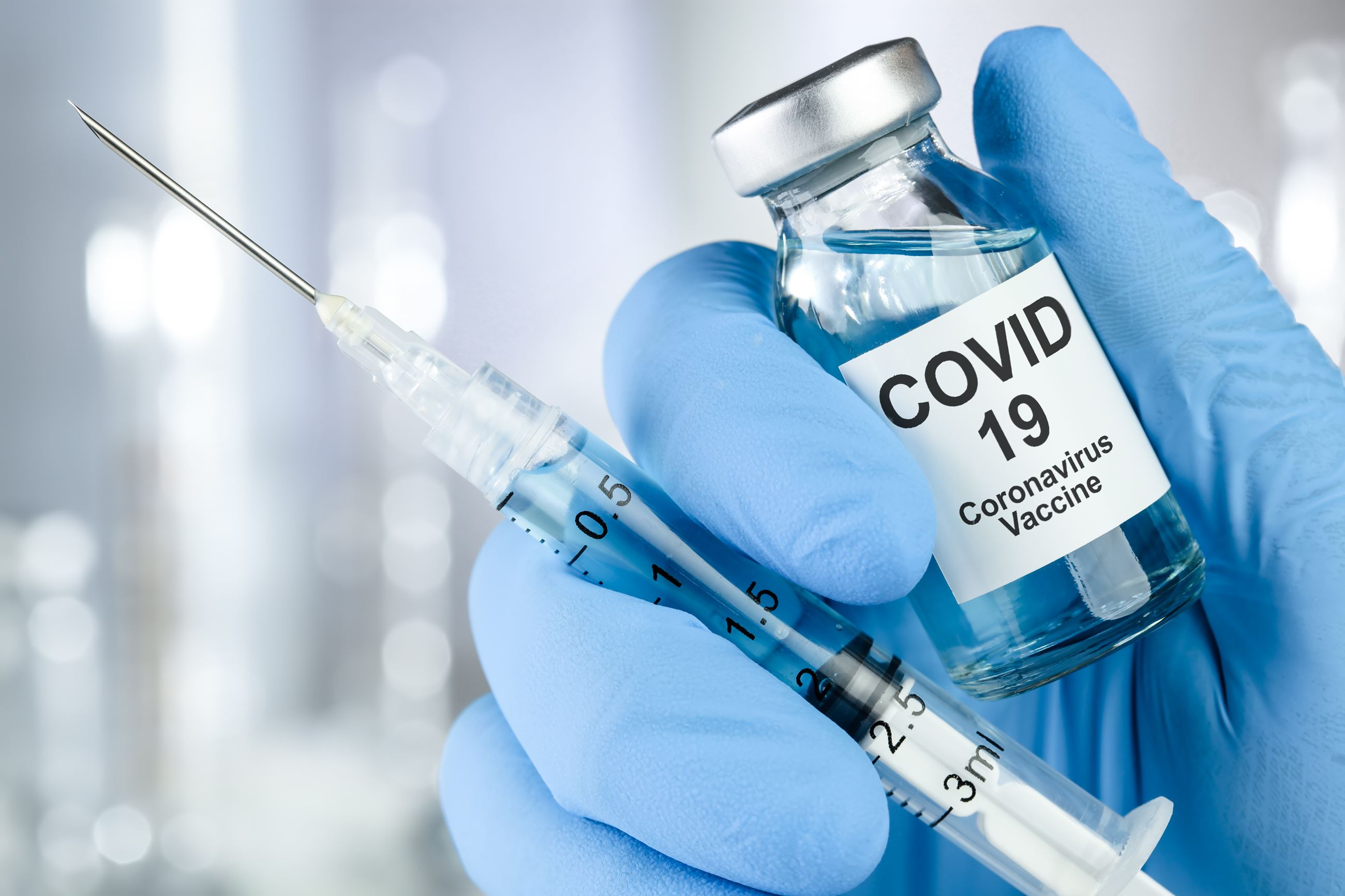 covid vaccine vial and needle
